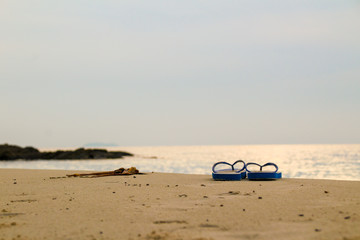 Holiday on beach concept alone Sandals