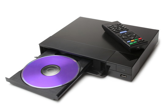 Blue Ray player with disk and remote control on white background