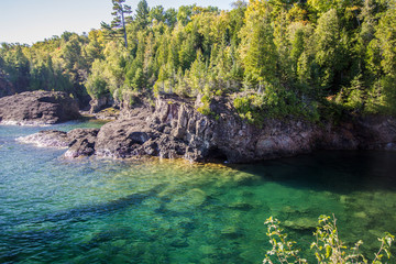 Lake Superior Cliffs. Cliffs in the Marquette Presque Isle city park is a popular cliff diving location in the Upper Peninsula of Michigan.