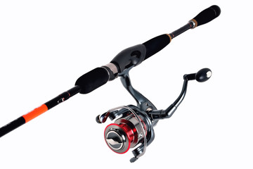 fishing reel on a fishing rod, white background close-up