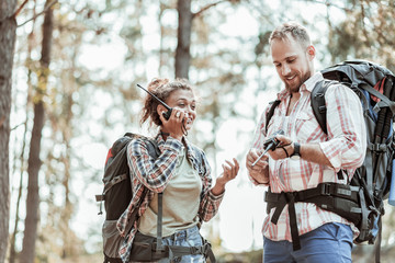 Portrait of backpackers. Portrait of two active good-looking backpackers enjoying their amazing day while hiking together