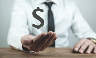 Man holding dollar symbol. Business concept