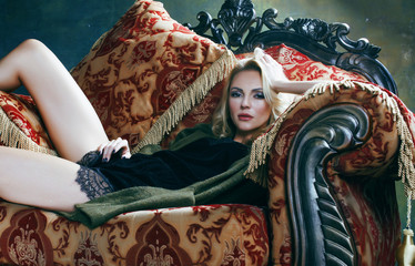 young blond woman in fairy luxury interior with  antique chair t
