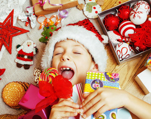 little cute boy with Christmas gifts at home. close up emotional