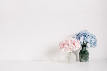 Foto op Canvas Hydrangea Pink and blue pastel hydrangea flower bouquets on white background. Minimal interior design concept.