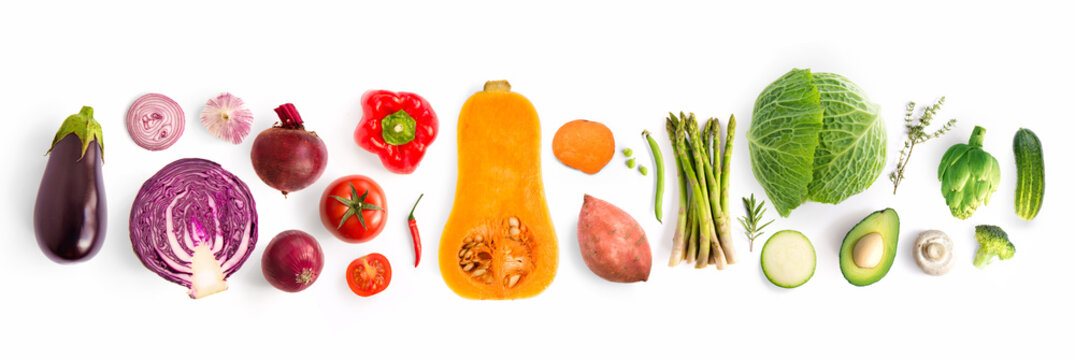 Creative layout made of green peas, cabbage, sweet potato, avocado, tomato, onion, beetroot, pepper, aubergine, artichoke, broccoli and cucumber on the white background.. Flat lay. Food concept.