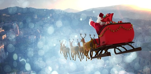 Composite image of santa claus riding on sleigh with gift box Wall mural