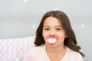 Slumber party photo booth props. Kid girl cheerful posing with toothy mouth lips smile party attribute. Prepare photo booth props hand made or buy for party. Printable photo booth props pajama party