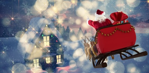 Composite image of santa claus riding on sled with gift box