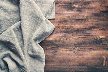 Gray tablecloth from left side wooden table top view. Food background