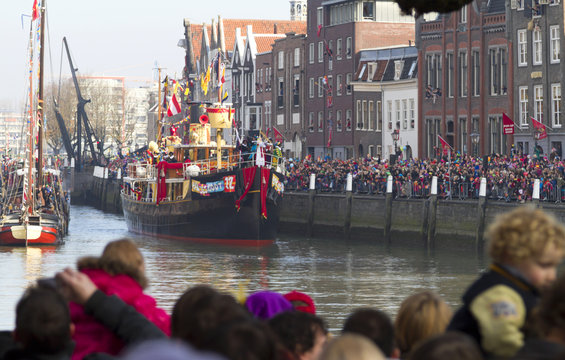 Ship of Saint Nicolas entering  the harbour of historical Dordrecht while the children wait in excited anticipation