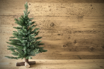 Green Christmas Tree On Brown Rustic Wooden Background
