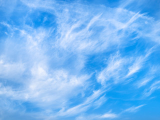 light spindrift clouds in blue sky in autumn