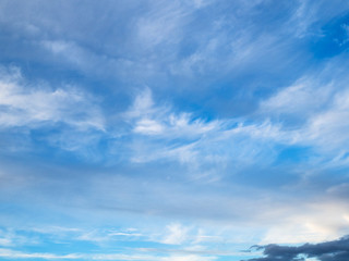 spindrift clouds in blue sky in autumn