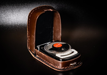 Vintage Exposure meter.Old handheld photometer used to calculate the proper adjustments