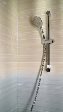 shower and shower holder. modern chrome shower attachment with thermostatic controller