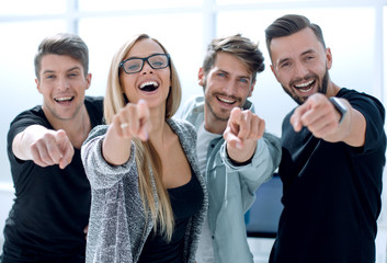happy business team chooses you at modern office