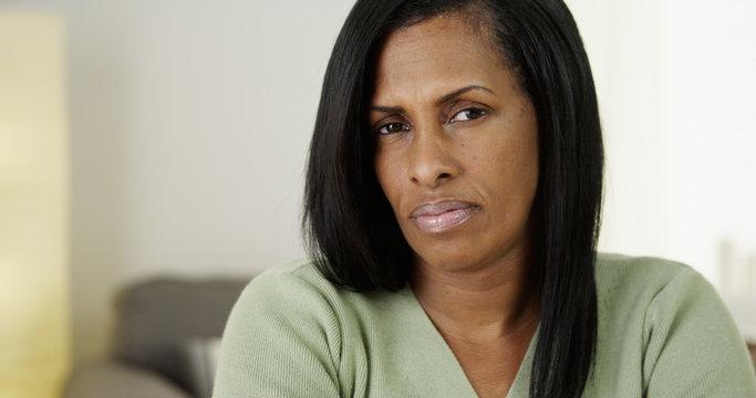 Unsatisfied Black senior woman looking at camera