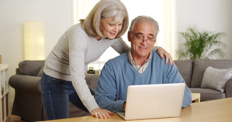 Mature couple using laptop computer together
