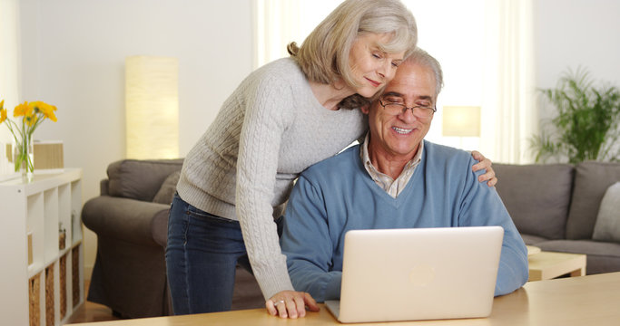 Senior couple using laptop computer together