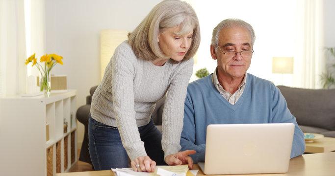 Mature couple doing finances on laptop computer