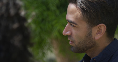 Profile of hispanic man in the park
