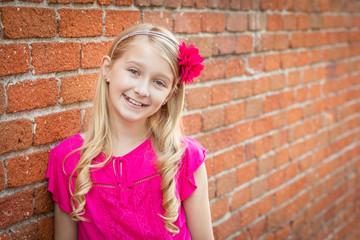Cute Young Caucasian Girl Portrait Against A Brick Wall