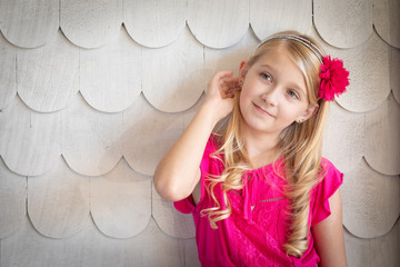 Cute Young Caucasian Girl Portrait Against A Wall