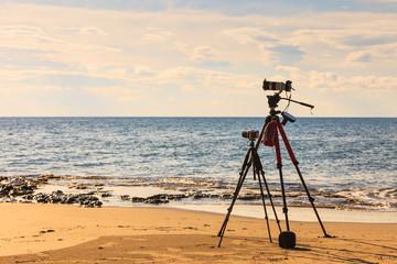 Camera taking picture film of sea coast