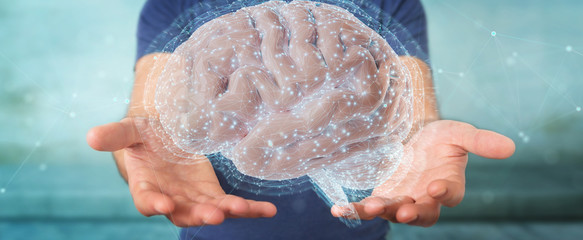 Wall Mural - Businessman using digital 3D projection of a human brain 3D rendering