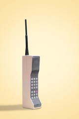 Vintage mobile, cell phone on a retro yellow background with space for copy and text
