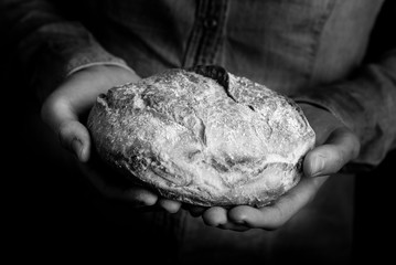 bread in the hands of a man