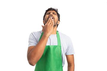 Yawning supermarket employee