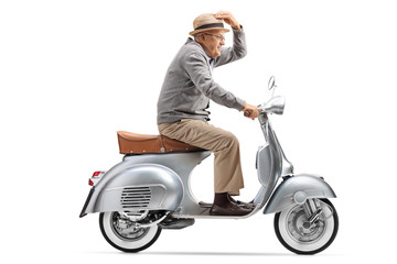 Gentleman riding a vintage motorbike