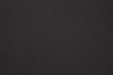 black paper texture background. colored cardboard fibers and grain. empty space concept.