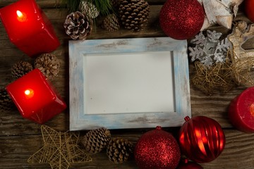 blue wooden frame with Christmas ornament
