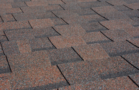 Asphalt shingles textured background. Roof shingles - roofing construction, roofing repair.