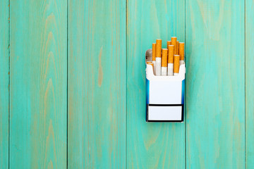 Cigarette with brown filter in the box