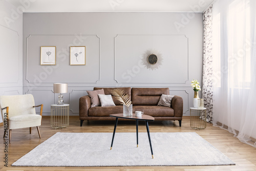 Minimal Interior Design Of Living Room With Brown Leather Couch