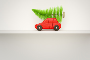 red toy car with green christmas tree