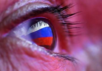 A Russian flag is reflected in an eye in this picture illustration