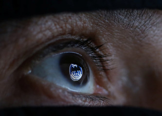 GRU, Russia's Main Intelligence Directorate logo is reflected in an eye in this picture illustration