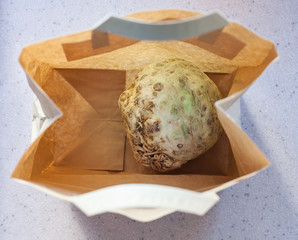 top view of celery root in a paper bag