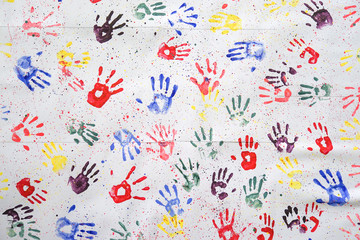 colorful hand prints. Kids colorful hand prints on the wall for color art background