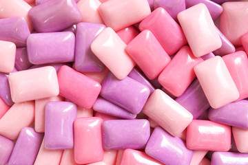 gum. colorful confectionary background of candy gums in different shades of pink and purple.