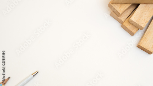 Wall mural wooden block and pen close up white background
