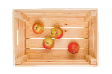 Few apples in wooden box on white background
