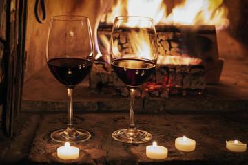 Romantischer Abend am Kamin, Rotwein trinken bei Kerzenschein Wall mural