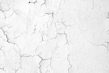 Texture of a white cracked wall. old dry background