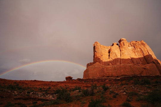 Rainbow after a thunderstorm at sunset in Arches National Park